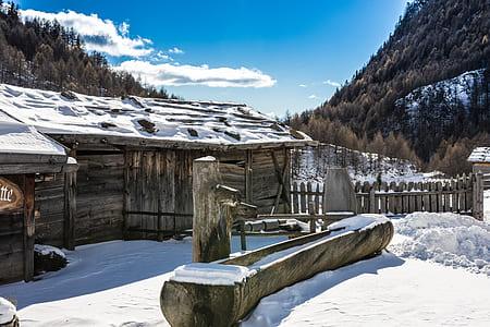 gray house near mountain during winter