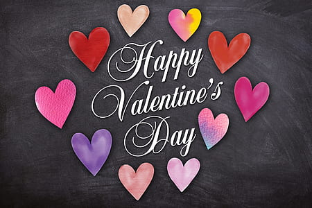 Happy Valentine's Day text on gray surface