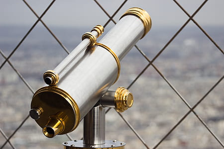 gray and brass telescope