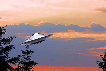gray spaceship under blue sky