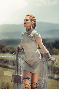 woman wearing gray mini dress with knitted cardigan