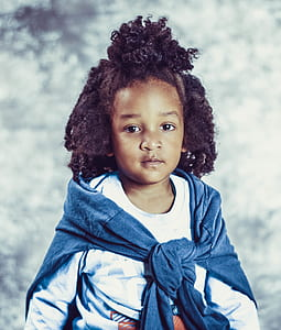 Photo of Kid With Blue Scarf and White Long-sleeve Top