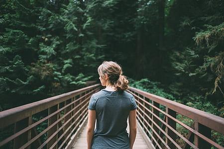 woman on bridge during daytime