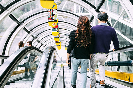 People going down the modern escalator at the Centre Pompidou in Central Paris, France. Image captured with a Canon 6D