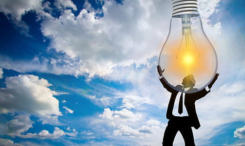 clip art of man holding light bulb