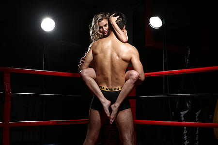 man carrying woman standing on ring side