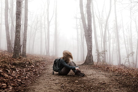 woman in the middle of forest during daytime