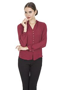 woman wearing red dress shirt and black pants