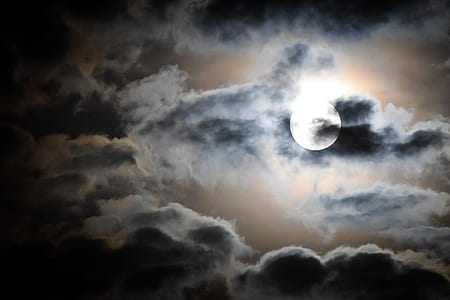 full moon and black clouds