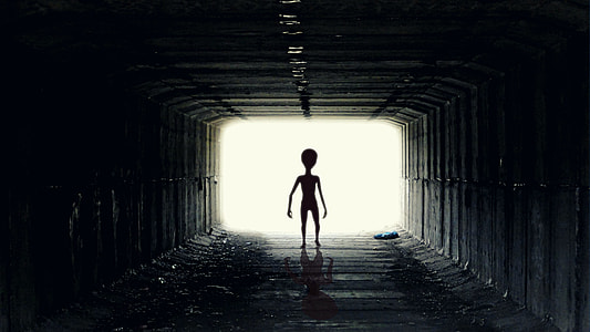 silhouette of a humanoid in a tunnel
