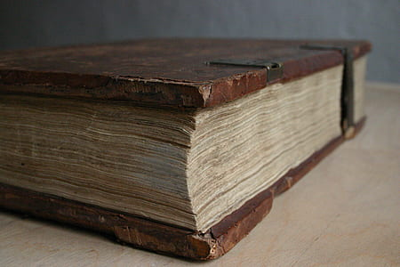 brown book on brown wooden table