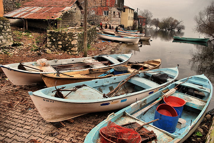 three boats beside body of water
