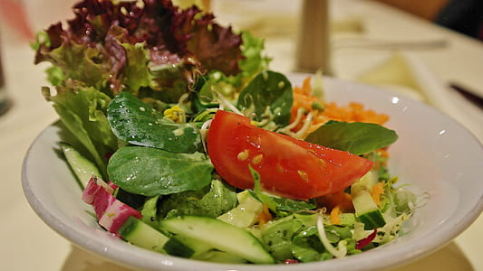 vegetable salad on white ceramic plae y