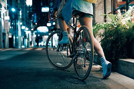 woman riding black bicycle