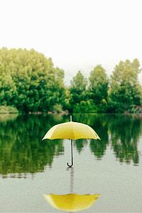 yellow umbrella on water
