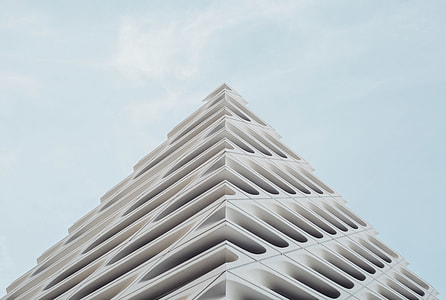 white concrete building in low angle photography