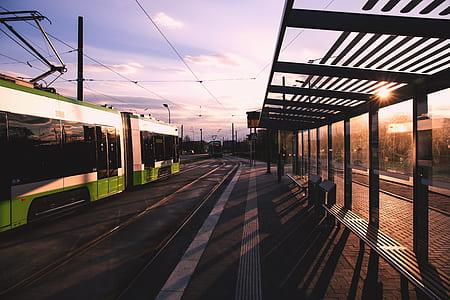 Green and White Train Near Train Terminal during Daytime