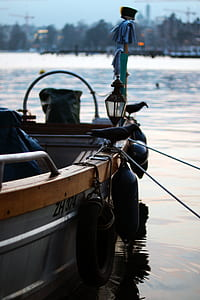 shallow focus photo of gray steel boat with black buoys