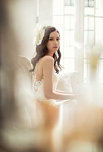 woman wearing white floral dress selected focus photography