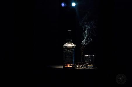 Closeup Photo of Liquor Bottle Against Black Background