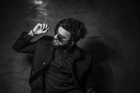 grayscale photography of man in black jacket wearing sunglasses