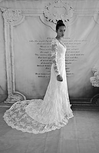 photo of woman in white floral laced long-sleeved bridal gown