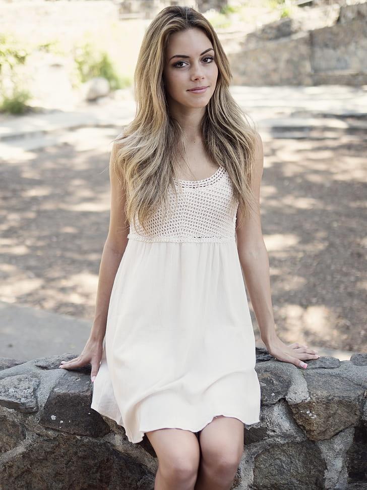 woman wearing white scoop-neck sleeveless dress