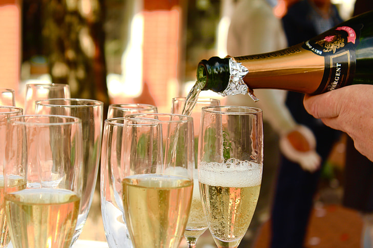 Royalty-Free photo: Person pouring champagne in glasses | PickPik