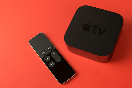 Overhead shot of the 4th generation Apple TV media player and touch remote control