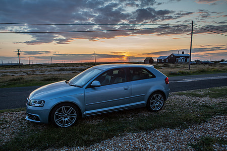 An Audi A3 S-Line sits at sunset on the Kent Coast in the South of England.