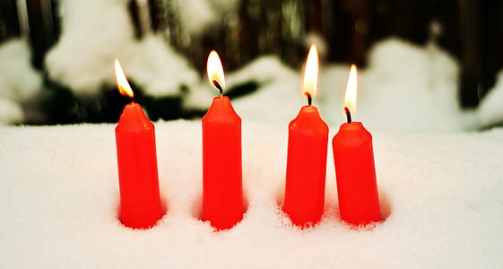 four red candles lighted