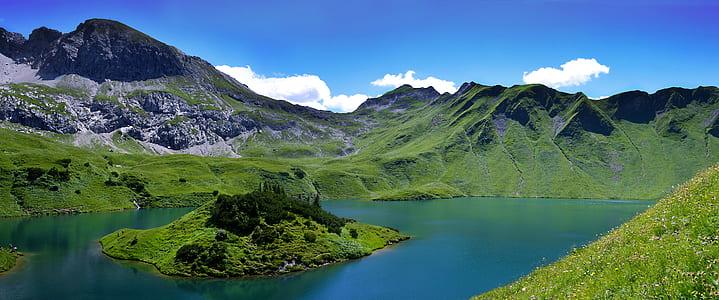 green mountain and lake