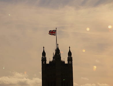 silhouette of tower with United Kingdom flag