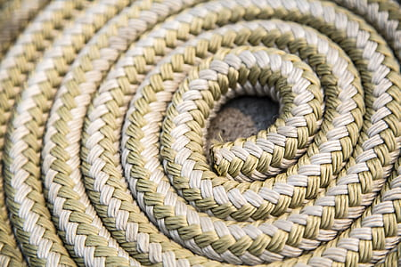 close-up photo of brown braided rope
