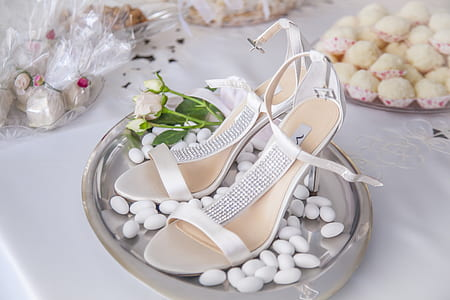 pair of white strap sandals on gray tray