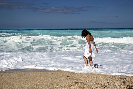 woman playing in the beach shore