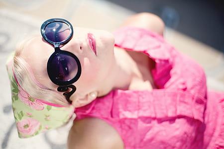 woman' wearing pink sleeveless top during daytime