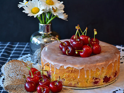baked cake with cherry toppings