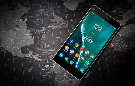black Xioami Android smartphone on top of world map illustration