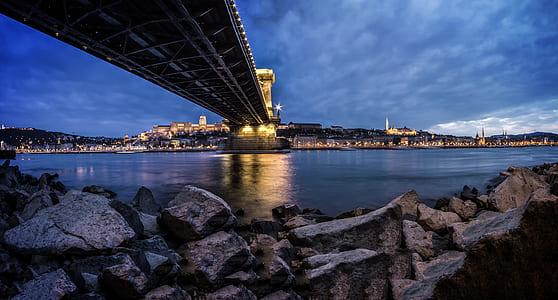 View of Rocky Shore Under Bridge
