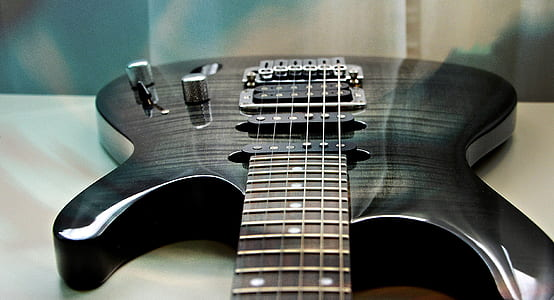 black electric guitar on table