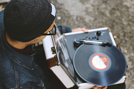 Man with a vinyl record player
