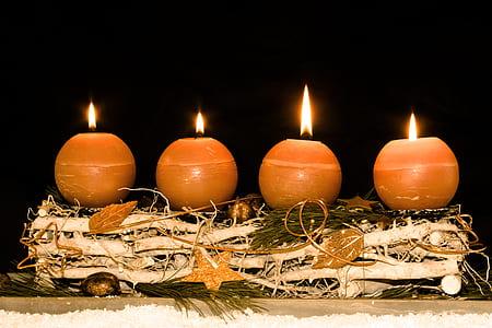 four brown pillar candles