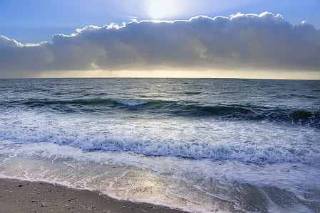 Ocean Under Blue Sky and White Clouds