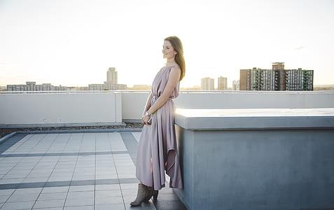 woman in gray sleeveless dress
