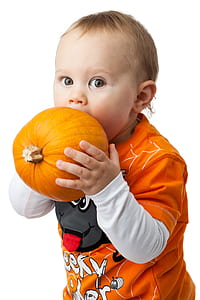 toddler about to bite pumpkin