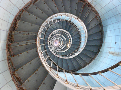high angle photo of spiral staircase