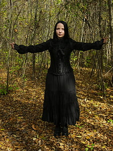 woman wearing black long-sleeved dress