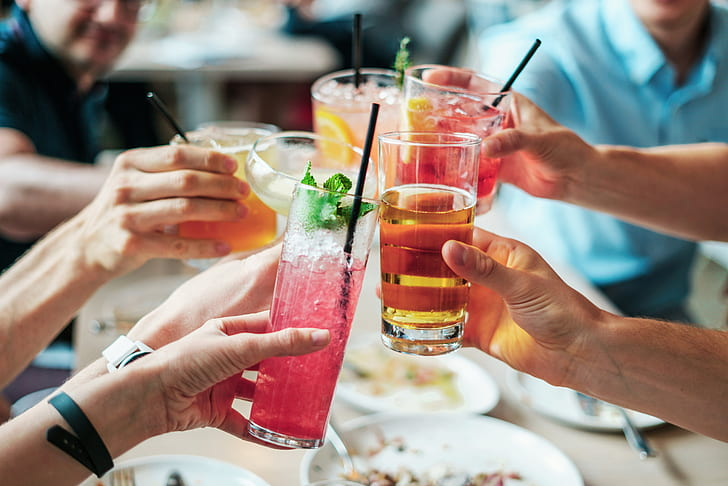 shallow focus photography of people having a toast