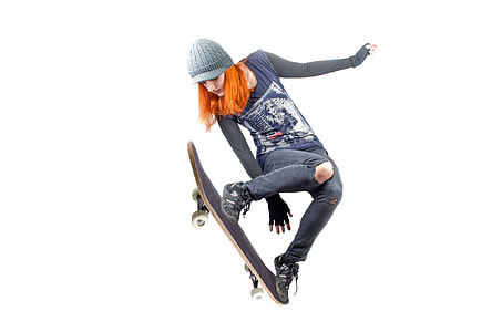 woman in blue and black long-sleeved shirt using skateboard